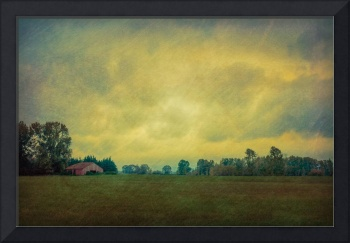 Small Red Barn Under Stormy Skies