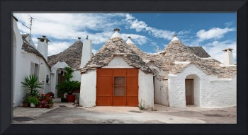 Some Trulli houses in a street