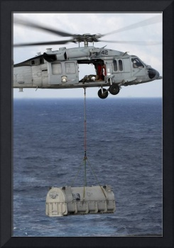 MH-60S Sea Hawk en route with a shipment of suppli