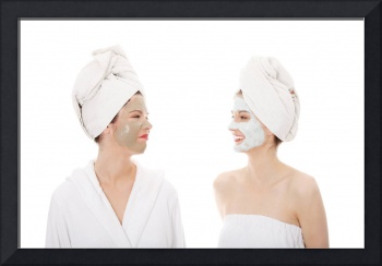 Happy two young woman with anti-aging masks.