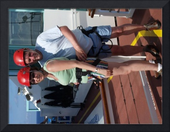 debs and peter climbing wall on ship