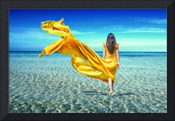 girl in a yellow dress in sea