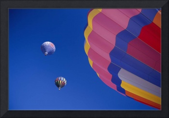 Colorful Hot Air Balloons Against Cloudless Blue S