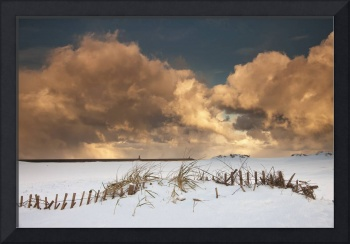 Illuminated Clouds Glowing Above A Snowy Field So