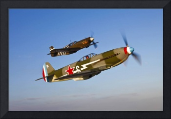A Yakovlev Yak-9 fighter plane and a P-51A Mustang
