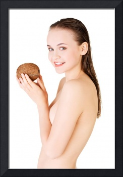 Beautiful woman with coconut in hands over white b