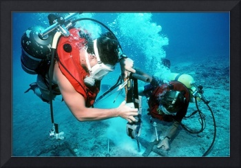 Divers work to repair an undersea cable at the Pac