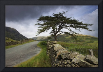A Stone Fence Running Along A Road Lake District,