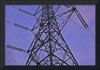 Pylons, in the landscape. Colour photography.