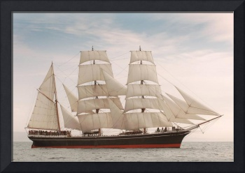 Vintage windjammer style ship with full sails on t