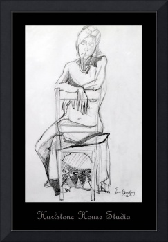 Seated nude resting on chair back