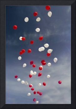 Red and white ballons are in blue sky