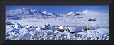 Frozen lake in front of a mountain range Black Mo
