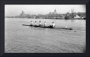 Group of boys rowing in front of the Vancouver Row