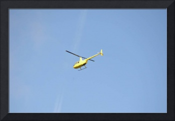 yellow R44 Helicopter