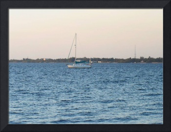 A Lone Sailboat In The Harbor