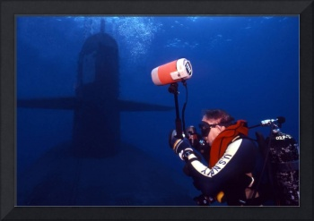 Underwater photographer takes photos of a US subma