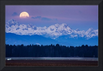 Full Moon setting over the Julian Alps