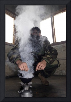 A marine fills the gas chamber with more CS gas