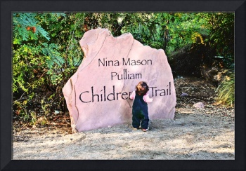 Children's Trail rock sign with toddler