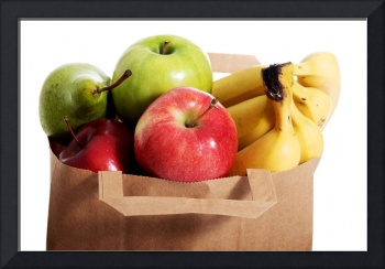Fruits in a paper bag. Isolated on white.