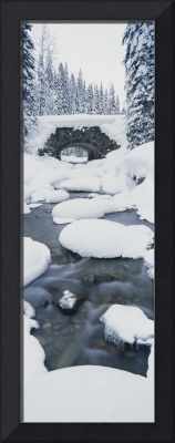 Snow covered bridge over a river