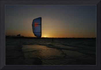Kiter Riding At Sunset