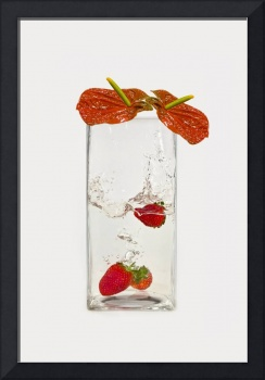 Red berries and flowers in water