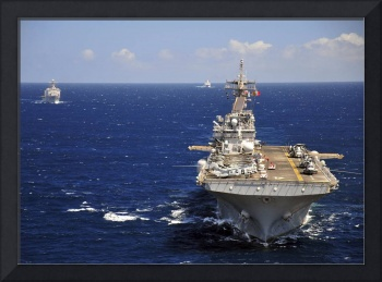 USS Boxer leads a convoy of ships in the Indian Oc