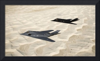 Two F-117 Nighthawk stealth fighters fly over Whit