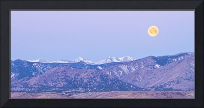 Full Moon Setting Over The CO Rocky Mountains