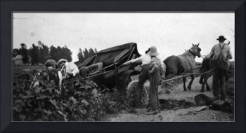Buick car stuck in ditch, horses pull it out