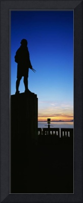 Captain Cook monument silhouetted by sunset