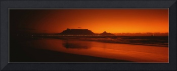 Silhouette of Table Mountain at sunset