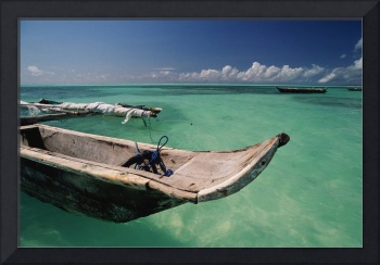 Outrigger in zanzibar's green waters