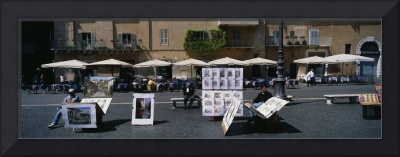 Artist selling his paintings in a market