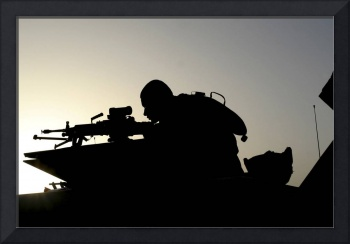 Silhouette of a Squad Automatic Weapon gunner