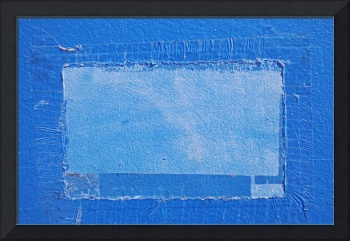 remnants of tape and sign on overpainted blue wall