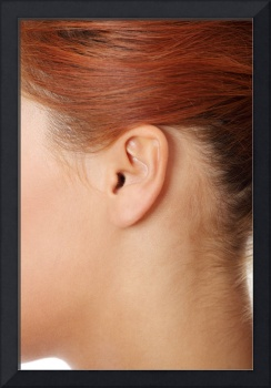 Young caucasian woman ear .