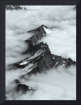 Cascades peaking over clouds