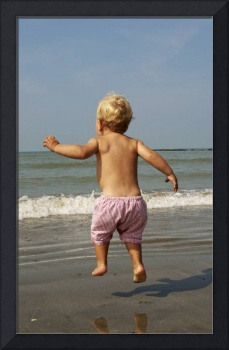Kid Jumping in front of the sea