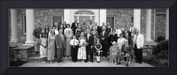 Portrait of newlywed couple and wedding guests