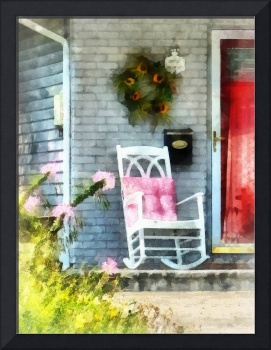Rocking Chair with Pink Pillow