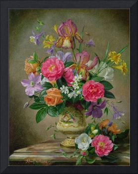 Peonies and irises in a ceramic vase