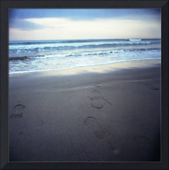 Foot prints at dawn on beach