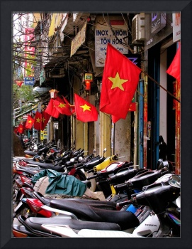 Motorcycles and flags in Hanoi, Vietnam