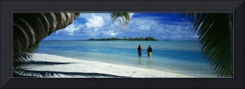 Rear view of two native teenage girls in lagoon