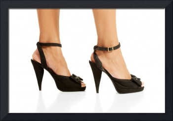 Woman's legs and high heel shoes ,isolated on whit