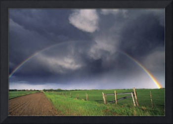 Rainbow Over Fields with Storm Clouds