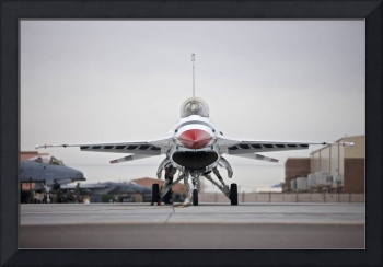 An F-16C Thunderbird sits on the ramp at Nellis Ai